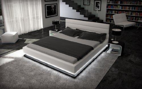 doppelbett kunstlederbett ripani 180 x 200 cm weiss schwarzes kopfteil mit ziern hten modernes. Black Bedroom Furniture Sets. Home Design Ideas